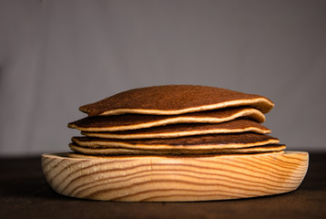 Pancakes on wooden plate