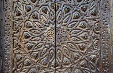 Ornaments of the bronze-plate ornate door of minbar of Al Sultan Hasan Mosque, historic public mosque located in Cairo, Egypt