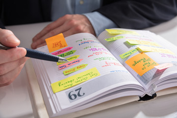 Fototapete - Businessperson's Hand Writing Note In Diary