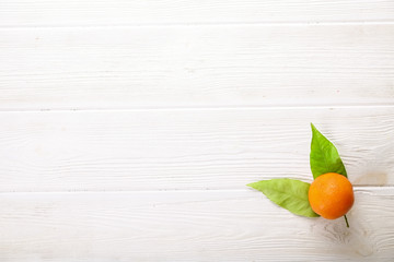 Mandarin Oranges on rustic white wooden background
