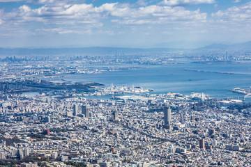 Kobe city in Japan. Modern populous cityscape background.