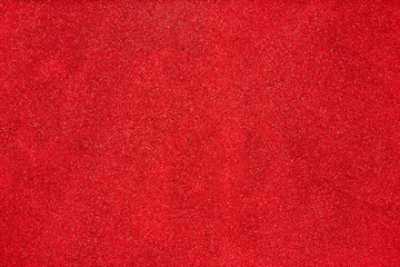 Aerial, top view of red glitter background