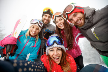 Happy group of skiers on skiing