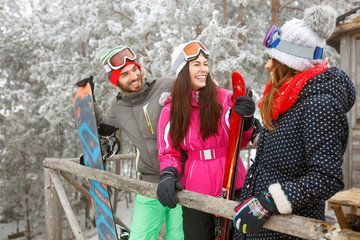 Young skiers in snowy mountain enjoying