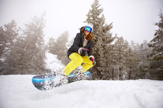 Trained woman snowboarding
