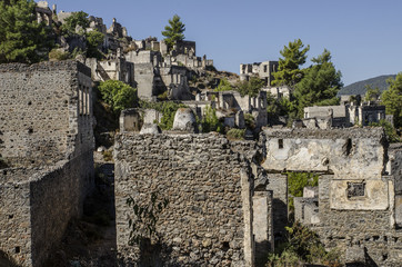 Turkey, the ghost town of Kayakoy, on the slope of the mountain abandoned houses, close-up depicts the walls of the ruined houses