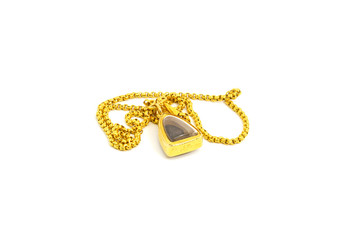 a golden necklace with amulet isolated on white background