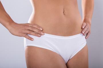 Woman body in white cotton underwear