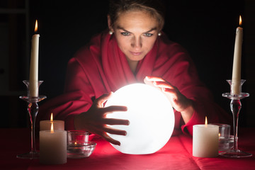 Fortuneteller Holding Hands Around A Glowing Ball
