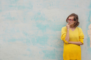 Girl with red glasses and yellow dress