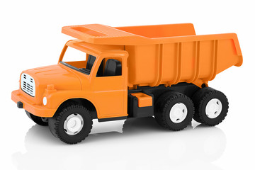 Vintage dump truck isolated on white background with shadow reflection. Plastic child toy on white backdrop. Dump tipper truck lorry construction vehicle.