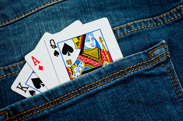 Playing cards in the back pocket of new jeans