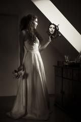 Young bride looking at mirror