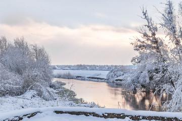 View from Lutsk park into the Styr river during winter snowfall. Lutsk, Ukraine.