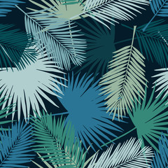 Seamless floral pattern with stylized fan and silk palm leaves. Jungle foliage, teal hues on navy blue background. Textile design.