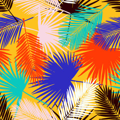 Seamless floral pattern with stylized fan and silk palm leaves. Jungle foliage, tropical hues on yellow background. Textile design.