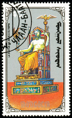 Ukraine - circa 2018: A postage stamp printed in Mongolia show Statue of Zeus. Series: 7 Wonders of the Ancient World. Circa 1990.