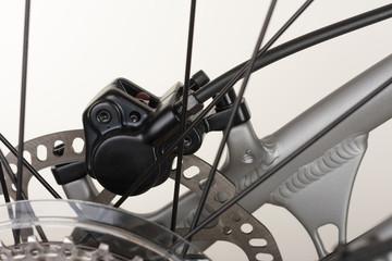 Hydraulic rear disc brake of mountain bike, close up view.