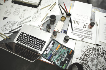 The Desk of artist, tattoo artists. Calligraphy. Top view sketches