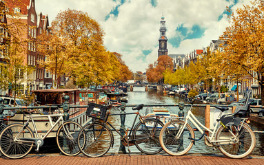 Printed kitchen splashbacks Beige Bike over canal Amsterdam city. Picturesque town landscape
