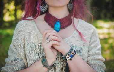Stylish woman with bracelets and necklace in boho gypsy style