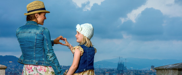 mother and daughter in Barcelona showing heart shaped hands