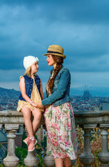 mother and daughter travellers in Barcelona enjoying evening