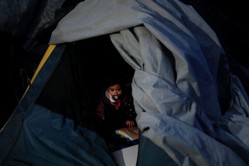 Child affected by the September 19 earthquake sits in a tent in provisional camp a few days before the 4th month anniversary of the devastating quake that left over 300 dead in Mexico City