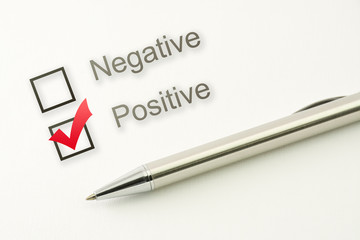 questionnaire: positive choice or negative, marked check box with a pen on paper background. Approval concept