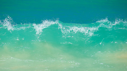 Breaking waves on a beach, Phuket Island, Thailand.