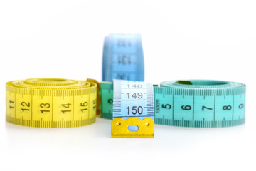 Measuring tapes of tailor with indicators in form of centimeters.