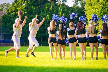 American Football Players With Cheerleaders