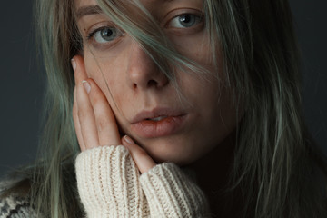 Cute Young woman with wool sweater and hair on face