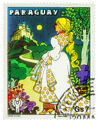 Cinderella going to the castle - scene from a fairy tale on postage stamp