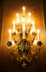 Light as many candles in the classic interior of the hotel