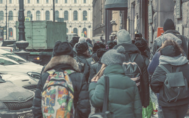 People on the streets of St. Petersburg in the winter