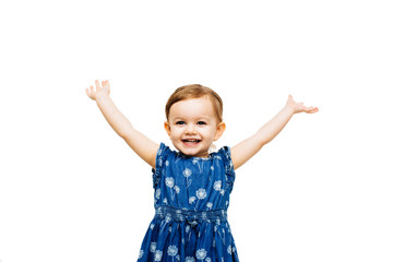 very happy toddler girl with arms outstretched up and a victorious smile Wall mural