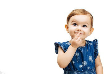 happy and curious toddler girl thinking with a finger on her mouth