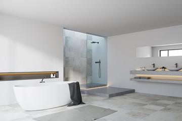 White and tiled bathroom corner
