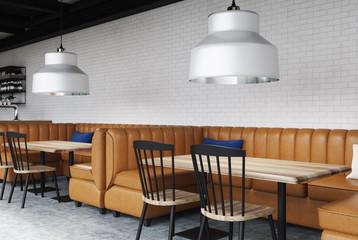 White cafe inteiror, brown sofas