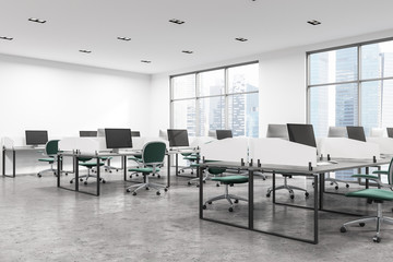 Open space office with green chairs
