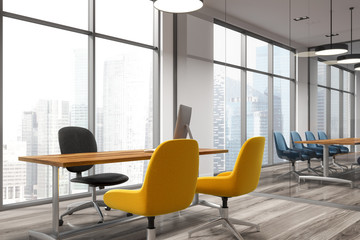 Meeting room corner, yellow and blue chairs