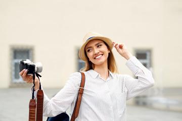 Beautiful Happy Girl Taking Photos On Camera.