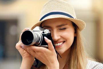 Woman Taking Photos On Camera On Street