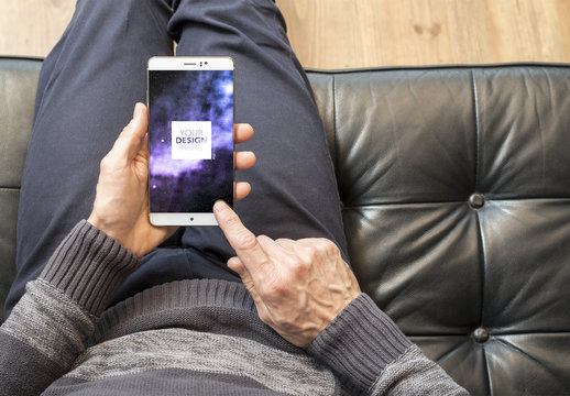 Top View Smartphone Mockup with Man on Sofa