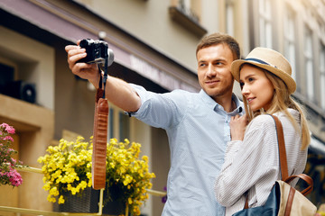 Tourist Couple In Love Taking Photos During Travel.