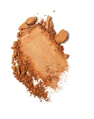 Broken powdered beige cosmetics on white background