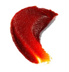 Smeared tomato paste on white background
