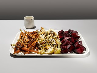 Roasted vegetables in tray gray background