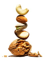 Stack of nuts balanced on walnut studio shot